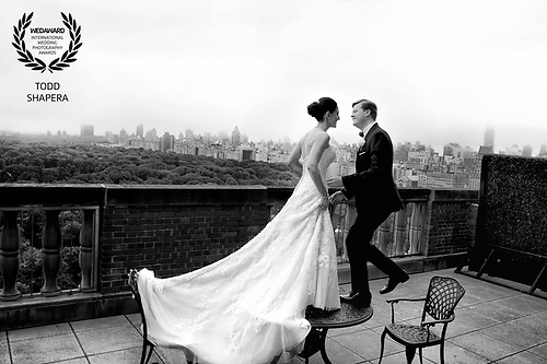 A New York wedding couple's first look on a deck at the New York Athletic Club, overlooking Central Park.