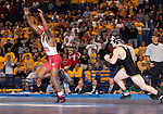 March 21 2009     Brent Metcalf from Iowa (black uniform) runs after Darrion Caldwell from North Carolina State (white and red uniform) after the match was over and Caldwell beat Metcalf in the 149 pound weight class in the championship round of the NCAA Division I  Wrestling Championships which were held March 19 through March 21, 2009 at the Scottrade Center in downtown St. Louis, Missouri.  Caldwell was about to do a flip, when Metcalf -- a sore loser over his loss - pursued Caldwell and knocked him down while he was in midair in his flip...         *******EDITORIAL USE ONLY*******