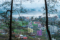 Family homes  in Galdhunga as seen from the highway leading by the Nagarjung National Park.
