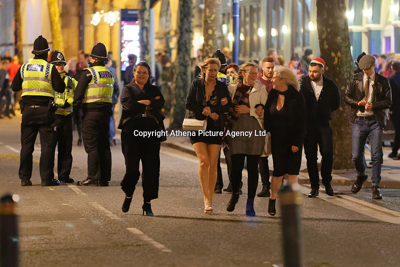Pictured: A group of women walk on the road. Friday 14 December 2018<br /> Re: Revellers in Wind Street, Swansea, Wales, UK.