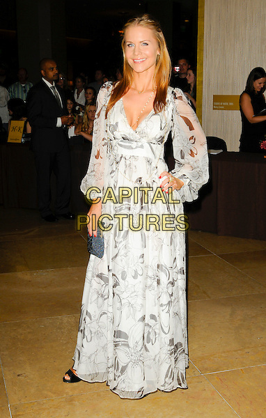 JOSIE DAVIS .arriving at Operation Smile at the Beverly Hilton Hotel in Beverly Hills, California, USA, October 2nd 2009..full length white print long maxi dress sleeves sleeved hand on hip sheer grey gray .CAP/ROT.©Lee Roth/Capital Pictures.