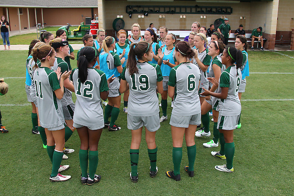 Denton, TX - AUGUST 31: North Texas Mean Green soccer team starting eleven during the national anthem prior to the start on the game against University of Houston Cougars at the Mean Green Village Soccer Field on August 31, 2012 in Denton, Texas. NT won 2-1.(Photo by Rick Yeatts)