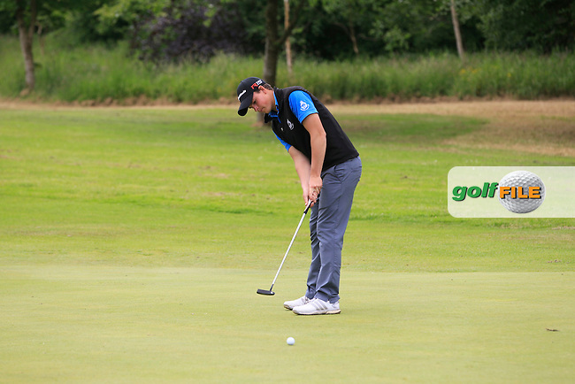 Jamie Knipe (Royal Portrush) on the 6th green during Round 2 of the Irish Boys Amateur Open Championship at Tuam Golf Club on Wednesday 24th June 2015.<br /> Picture:  Thos Caffrey / www.golffile.ie
