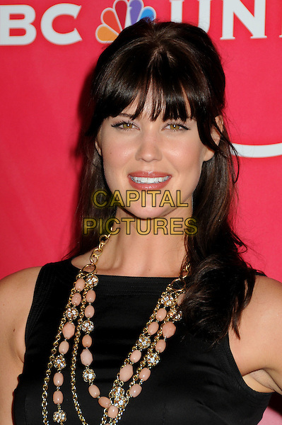 SARAH LANCASTER .NBC Universal Press Tour Cocktail Party held at the Langham Hotel, Pasadena, California, USA, 10th January 2010..portrait headshot black fringe necklace peach beads gold .CAP/ADM/BP.©Byron Purvis/AdMedia/Capital Pictures.