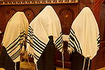 Israel, Bnei Brak. The Synagogue of the Premishlan congregation on Purim holiday, the priests are covering their heads with the Taliths during the Priestly Blessing prayer, 2005<br />