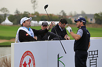 Graeme McDowell (NIR), caddy Ken Comboy, Pete Cowan and Colin on the 15th tee during Wednesday's Pro-Am Day of the 2014 BMW Masters held at Lake Malaren, Shanghai, China 29th October 2014.<br /> Picture: Eoin Clarke www.golffile.ie