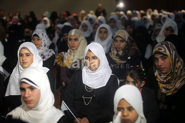 Palestinians attend a ceremony to honor the servants of Quran, in Gaza city on January 25, 2015. Photo by Ashraf Amra