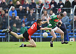 Cillian Brennan of Clondegad in action against Keelan Sexton of Kilmurry Ibrickane during their senior county final at Cusack park. Photograph by John Kelly.