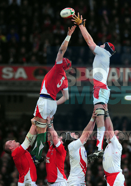 Alun Wyn Jones of Wales and Nick Kennedy of England contest the line out