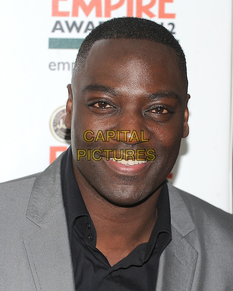 Adewale Akinnuoye Agbaje.Jameson Empire Film Awards at the Grosvenor House Hotel, Park Lane, London, England..March 25th 2012.headshot portrait black grey gray.CAP/BF.©Bob Fidgeon/Capital Pictures.