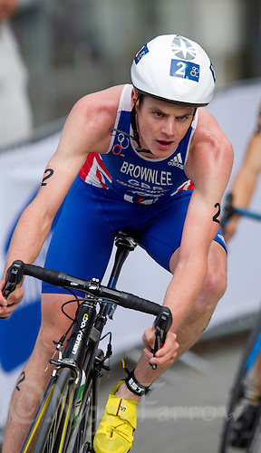 25 AUG 2012 - STOCKHOLM, SWE - Jonathan Brownlee (GBR) of Great Britain on the bike during the elite men's 2012 ITU World Triathlon Series round in Gamla Stan, Stockholm, Sweden .(PHOTO (C) 2012 NIGEL FARROW)