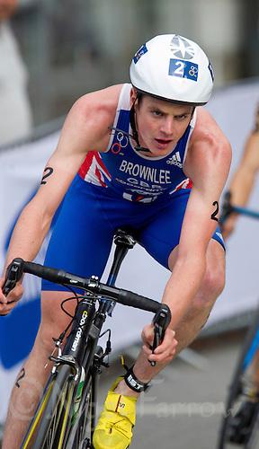 25 AUG 2012 - STOCKHOLM, SWE - Jonathan Brownlee (GBR) of Great Britain on the bike during the elite men's 2012 ITU World Triathlon Series round in Gamla Stan, Stockholm, Sweden .(PHOTO (C) 2012 NIGEL FARROW)