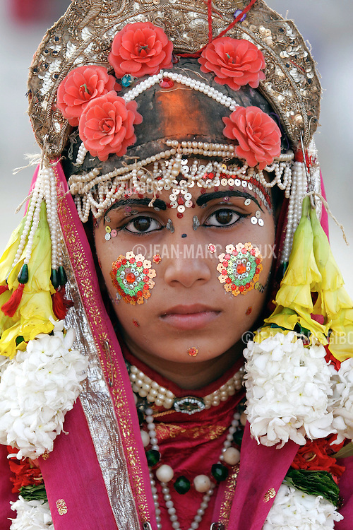 .RAMNAGAR, UTTAR PRADESH, INDIA - OCTOBER 5, 2005 : Sita, the loyal wife of Lord Rama, is played by a young boy like all the main God characters of the Ramlila theatre,in Ramnagar on October 2, 2005. The Ramlila is the play of the Hindu scripture 'the Ramayana' which depict the struggle of the god Ram and his fight against the Demon God Ravana. The Ramlila of Ramnagar has been organized by the Maharaja of Benares since the early 1800s and is still its most authentic rendition, a reference to other Ramlilas. It last for 31 days and is staged over a 10 square mile area. It is the largest play to be produced in the world .(Photo by Jean-Marc Giboux/Getty Images)