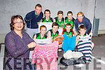Ann Burke-O'Donoghue and the Rathmore Ravens basketball club who are clothes donations front row:  Daniel Healy, Sean kennedy, Kieran Fitzgerald, sean Burke-O'Donoghue. Back row: Paud Cremins, Daniel Moynihan, andrew Moynihan, denis Mahony and Valraie Lenihan