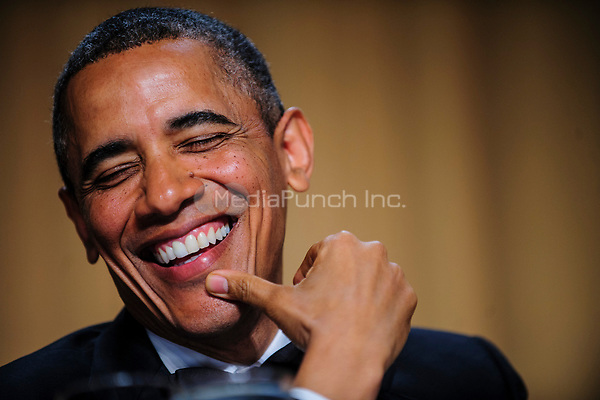 United States President Barack Obama reacts to a joke told by comedian Conan O'Brien during the White House Correspondents' Association (WHCA) annual dinner in Washington, District of Columbia, U.S., on Saturday, April 27, 2013.<br /> Credit: Pete Marovich / Pool via CNP /MediaPunch