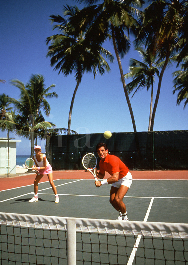 Couple playing tennis, Jamaica