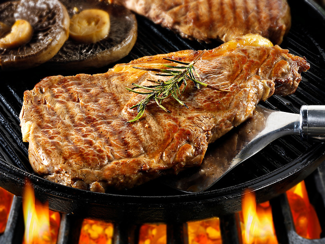 Sirloin beef steaks & mushrooms being pan fried on a bbq. Meat food photos, pictures & images.