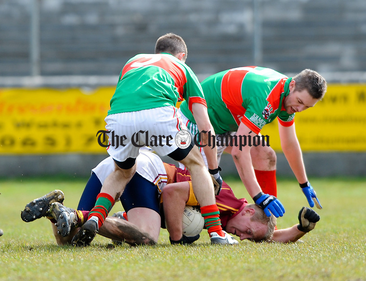 Matk Killeen and Enda Coughlan/10 John Meade of St Joseph's Miltown Malbay is put under pressure by Mark Killeen and Enda Coughlan of Kilmurry Ibrickane during their Cusack Cup game in  Miltown Malbay. Photograph by John Kelly.