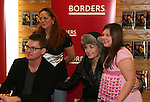 Ewa da Cruz and Trent Dawson - ATWT pose with fans and sign for fans The Man from Oakdale - a Novel by Henry Coleman with Alina Adams on January 31, 2009 at Borders in Westbury, New York.