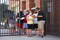 A Charlotte Knights staff member checks in a guest prior to the  Southern Collegiate Baseball League game between the Concord Athletics and the Piedmont Pride at Truist Field on July 3, 2020 in Charlotte, NC. Truist Field allows restaurant reservations for no more than 25 people to a space to encourage proper social distancing. (Brian Westerholt/Four Seam Images)