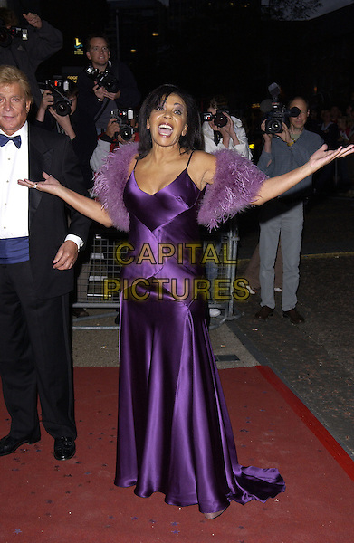 SHIRLEY BASSEY.Arrivals At The Avenue To The Stars 50 Years Of ITV event held at LWT studios,.London, 18th September 2005.full length purple satin strappy dress faux fake fur wrap arms hands.Ref: FIN.www.capitalpictures.com.sales@capitalpictures.com.© Capital Pictures.