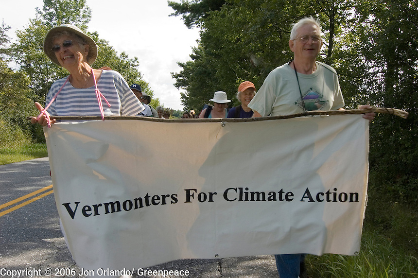 Carol (left) and Reg Spooner of Waybridge, Vermont lead marchers on the second day of a five day walk across Vermont to raise awareness on Global Warming.