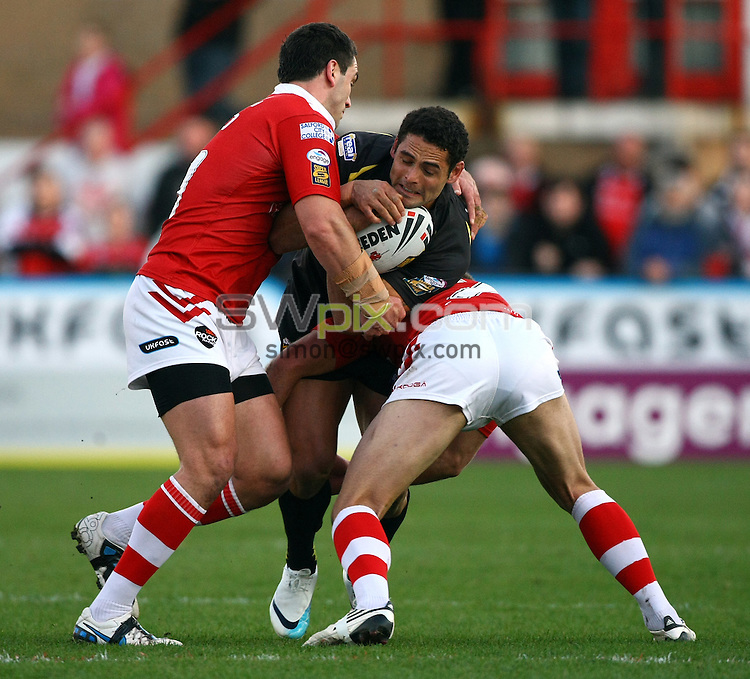 PICTURE BY VAUGHN RIDLEY/SWPIX.COM...Rugby League - Super League - Salford City Reds v Crusaders RL - The Willows, Salford, England - 02/04/11...Salford's Stephen Wild and Daniel Holdsworth tackle Crusaders Hep Cahill.