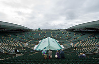 A general view of Court 1, under cover on a rain delayed Day 8<br /> <br /> Photographer Ashley Western/CameraSport<br /> <br /> Wimbledon Lawn Tennis Championships - Day 8 - Tuesday 11th July 2017 -  All England Lawn Tennis and Croquet Club - Wimbledon - London - England<br /> <br /> World Copyright &copy; 2017 CameraSport. All rights reserved. 43 Linden Ave. Countesthorpe. Leicester. England. LE8 5PG - Tel: +44 (0) 116 277 4147 - admin@camerasport.com - www.camerasport.com