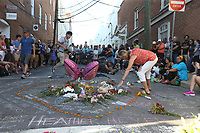A large vigil came together Sunday night for Heather Heyer at 4th Street SE and Water Street in Charlottesville, Va. Heyer was killed and 19 others injured when a car intentionally ran through a crowd of counter protestors after the Unite The Right rally. Photo/Andrew Shurtleff/The Daily Progress