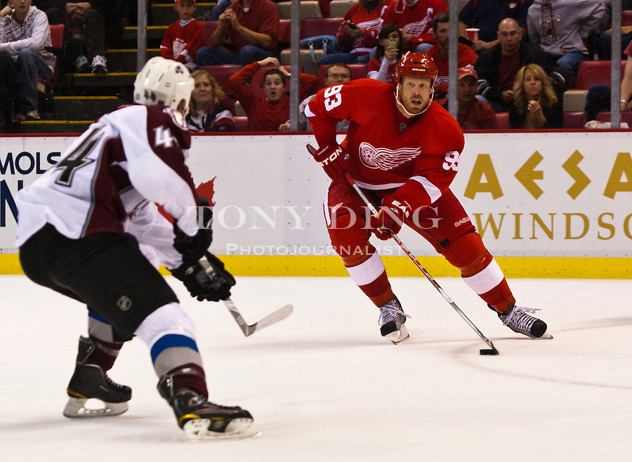 12 October 2010: Detroit Red Wings forward Johan Franzen (93) handles the puck in the third period of the Colorado Avalanche at Detroit Red Wings NHL hockey game, at Joe Louis Arena, in Detroit, MI. Colorado won 5-4 in shootouts...***** Editorial Use Only *****