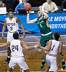 SIOUX FALLS, SD: MARCH 20:  Tom Brown #4 of Le Moyne rebounds over West Texas A&M defenders during their game at the 2018 Division II Men's Elite 8 Basketball Championship at the Sanford Pentagon in Sioux Falls, S.D. (Photo by Dick Carlson/Inertia)