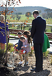 AUSTRALIA, Canberra : Britains Prince William (R) watches as Catherine, Duchess of Cambridge (C) instructs the watering of the tree at the National Arboretum, Canberra on April 24, 2014. Britain's Prince William, his wife Kate and their son Prince George are on a three-week tour of New Zealand and Australia. AFP PHOTO / Mark GRAHAM