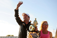 Nov 13, 2010; Pomona, CA, USA; NHRA pro stock driver Greg Anderson (left) with wife Kim Anderson celebrate after clinching the 2010 pro stock championship during qualifying for the Auto Club Finals at Auto Club Raceway at Pomona. Mandatory Credit: Mark J. Rebilas-