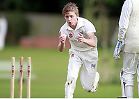 William Brookes of Highgate celebrates bowling Arsalan Khalid during the ECB Middlesex Division Three game between Highgate and Harrow Town at Park Road, Crouch End on Saturday May 24, 2014