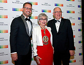 From left, Producer Brent Miller, 2015 Kennedy Center Honoree Rita Moreno, and manager John Ferguson arrive for the formal Artist's Dinner honoring the recipients of the 40th Annual Kennedy Center Honors hosted by United States Secretary of State Rex Tillerson at the US Department of State in Washington, D.C. on Saturday, December 2, 2017. The 2017 honorees are: American dancer and choreographer Carmen de Lavallade; Cuban American singer-songwriter and actress Gloria Estefan; American hip hop artist and entertainment icon LL COOL J; American television writer and producer Norman Lear; and American musician and record producer Lionel Richie.  <br /> Credit: Ron Sachs / Pool via CNP