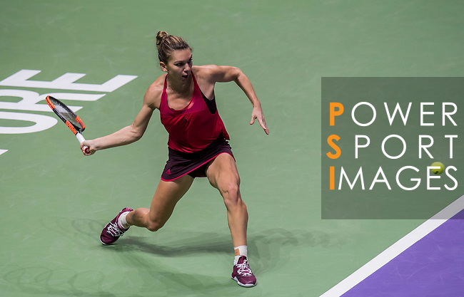 Simona Halep of Romania hits a shot in her singles match against Elina Svitolina of Ukraine during the BNP Paribas WTA Finals Singapore presented by SC Global at Singapore Sports Hub on 27 October 2017 in Singapore. Photo by Victor Fraile / Power Sport Images