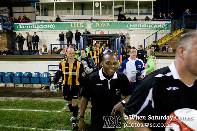 16.09.2008 Leek, England. The players of Leek Town (blue) and Clitheroe walking onto the pitch with match officials prior to the clubs FA Cup 1st Qualifying Round replay at Harrison Park, Leek. The first match ended in a one-all draw but it was Clitheroe who progressed to the next round winning the replay one-nil, despite having a man sent off in the second half. The preliminary stages of the FA Cup were used to determine which non-League clubs were included in the first round proper of the FA Cup. Photo by Colin McPherson.