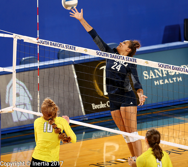 BROOKINGS, SD - SEPTEMBER 1: Heaven Harris #24 from Northern Arizona tips the ball over the net past Allison Ketcham #10 from Valparaiso during their match Friday afternoon at the Jackrabbit Invitational at Frost Arena in Brookings. (Photo by Dave Eggen/Inertia)