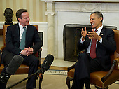 Prime Minister David Cameron of Great Britain and United States President Barack Obama meet in the Oval Office the White House in Washington, D.C. on Wednesday, March 14, 2012 following the Official Arrival Ceremony in Cameron's honor..Credit: Ron Sachs / CNP