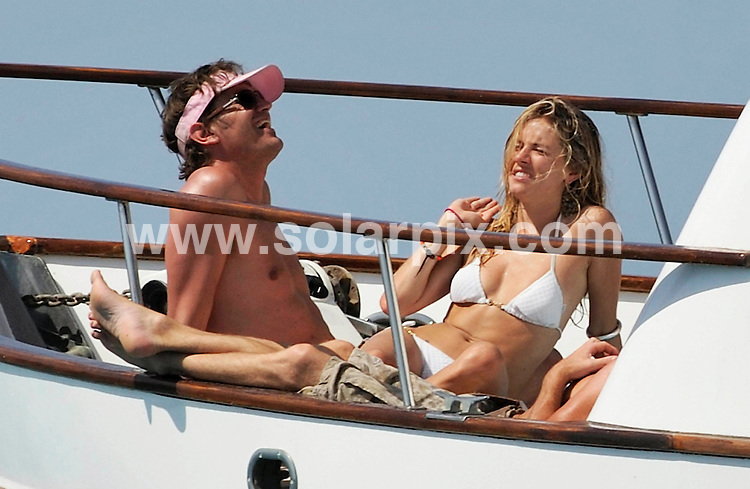 **ALL ROUND PICTURES FROM SOLARPIX.COM**.**SYNDICATION RIGHTS FOR UK, ASIA, AUSTRALIA, CANADA, DUBAI, GREECE, NEW ZEALAND, RUSSIA, SOUTH AFRICA, SOUTH AMERICA, AND USA**.Sienna Miller & new boyfriend George Barker enjoying the sunshine on board a boat off the island of Ibiza..JOB REF:    9760   SPA     DATE:  14.08.09.**MUST CREDIT SOLARPIX.COM OR DOUBLE FEE WILL BE CHARGED**.**MUST NOTIFY SOLARPIX OF ONLINE USAGE**.**CALL US ON: +34 952 811 768 or LOW RATE FROM UK 0844 617 7637**
