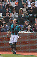 Coastal Carolina Chanticleers catcher Tucker Frawley #8 during a game against the University of Virginia Cavaliers at Watson Stadium at Vrooman Field on February 18, 2012 in Conway, SC. Frawley had just caught a foul ball for an out.  Virginia defeated Coastal Carolina 9-3. (Robert Gurganus/Four Seam Images)