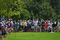 Rory McIlroy (NIR) hits his approach shot from near the trees on 8 during round 1 of the 2019 Tour Championship, East Lake Golf Course, Atlanta, Georgia, USA. 8/22/2019.<br /> Picture Ken Murray / Golffile.ie<br /> <br /> All photo usage must carry mandatory copyright credit (© Golffile | Ken Murray)