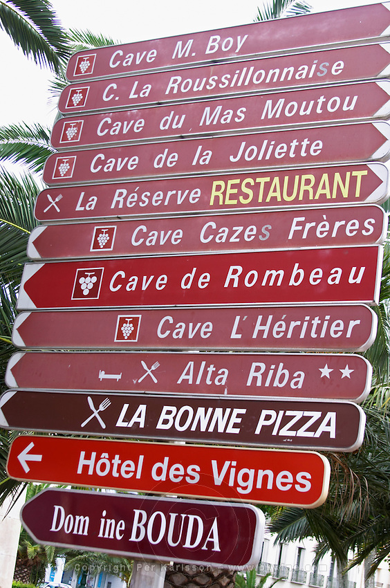 Signs to wine producers and restaurants. Rivesaltes town, Roussillon, France