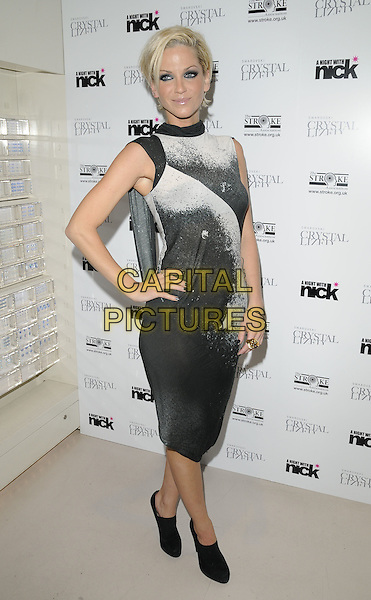 "SARAH HARDING (GIRLS ALOUD) .Attending ""A Sparkling Night With Nick"" charity evening, Swarovski Crystallized Lounge, London, England, .3rd December 2009..full length sleeveless black grey gray white dress side ankle boots shooboots booties tattoo hand on hip print .CAP/CAN.©Can Nguyen/Capital Pictures"