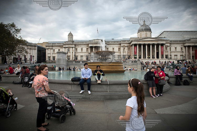 Tourists in Trafalgar Square.