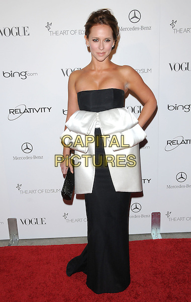 "JENNIFER LOVE HEWITT .attends the Art of Elysium 4th Annual Charity Gala ""Heaven"" held at The Annenberg Building at The California Science Center in Los Angeles, California, USA, January 15th 2011..full length black white strapless dress long maxi peplum hand on hip clutch bag                                          .CAP/RKE/DVS.©DVS/RockinExposures/Capital Pictures."