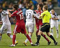 CARSON, CA – July 9, 2011: LA Galaxy midfielder David Beckham (23) and Chicago FIre midfielder Baggio Husidic (9) during the match between LA Galaxy and Chicago Fire at the Home Depot Center in Carson, California. Final score LA Galaxy 2, Chicago Fire FC 1.