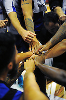 The Saints huddle during the national basketball league match between Wellington Saints and Taranaki Mountain Airs at TSB Bank Arena, Wellington, New Zealand on Friday, 17 April 2015. Photo: Dave Lintott / lintottphoto.co.nz