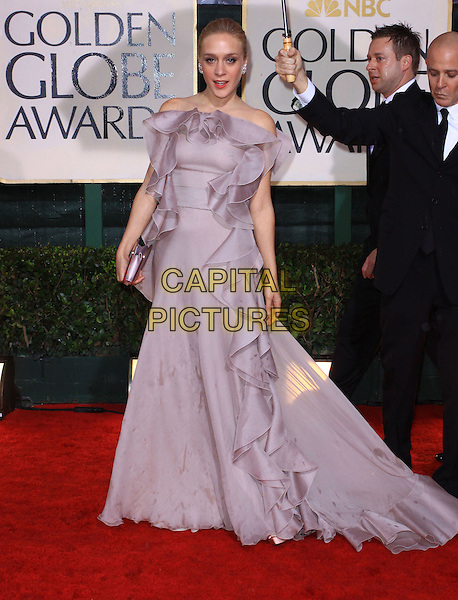 CHLOE SEVIGNY.67th Golden Globe Awards held Beverly Hilton, Beverly Hills, California, USA..January 17th, 2010.globes full length lilac purple grey gray dress gown wavy strapless ruffle ruffles wet raining clutch bag silk chiffon .CAP/ADM/KB.©Kevan Brooks/Admedia/Capital Pictures