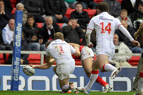 29.10.2011 Leigh England. Elliot Kear (Crusaders) goes over for a try during the Gillette Four Nations Rugby League match between England and Wales played at the Leigh Sports Village. Mandatory Credit: Actionplus